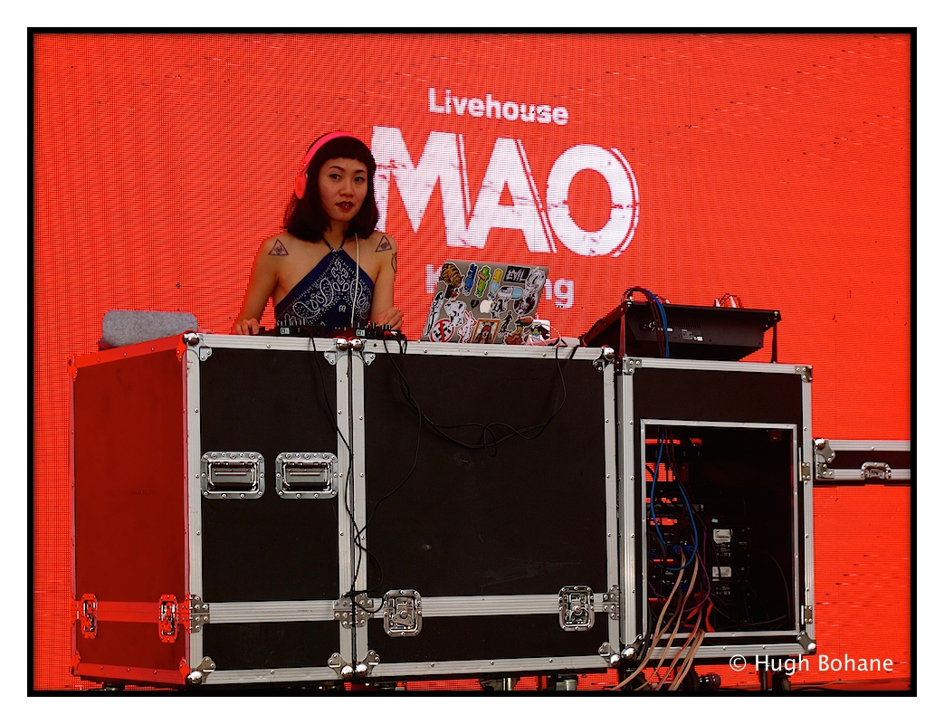 DJ playing on the small stage